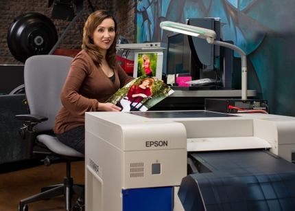 CS Photography Staff Smiles Along With Completed Image from an Epson SureLab D3000 Printer