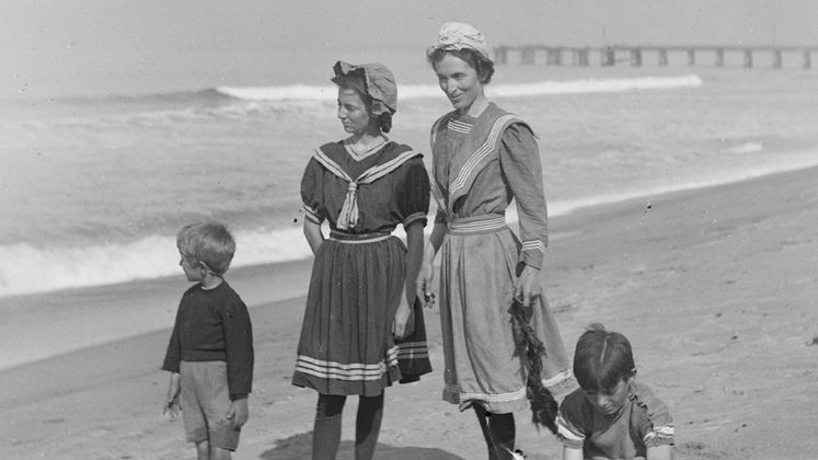 Two women and two young boys at the beach