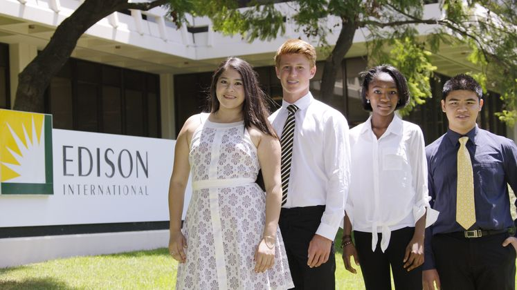 Edison Scholarship Winners in Front of Edison Sign