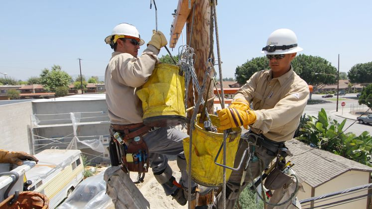Field crews conduct maintenance on distribution pole