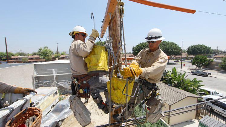 Field crews conduct maintenance on distribution pole (2)