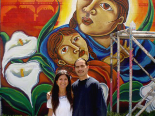 Leap with former gang member Fabian Debora in front of mural he painted in East Los Angeles. Debora also created the artwork for the cover of Leap's book.