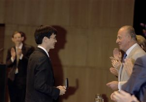 Terence Tao receiving the Fields Medal from King Juan Carlos I of Spain at the International Congress of Mathematicians in Madrid on Aug. 22, 2006.