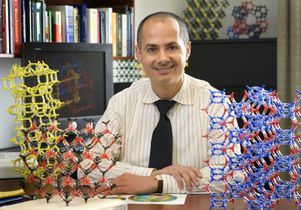 Omar M. Yaghi with structure models