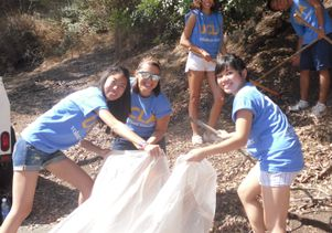 Students at work raking and cleaning griffith park hillside