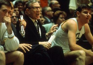 Coach Wooden on the bench