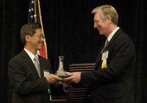 James C. Liao accepts award