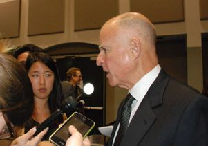 Jerry Brown with reporters