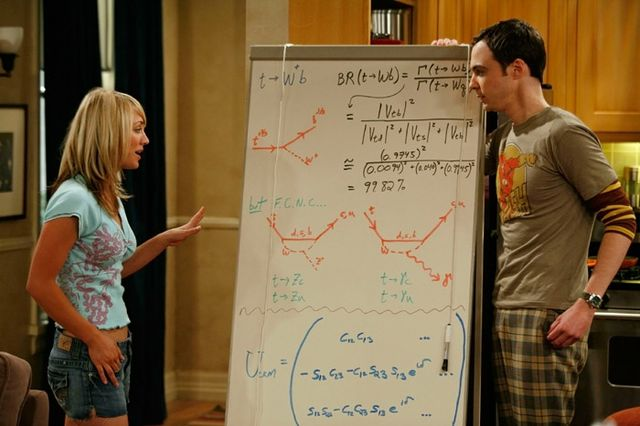 """Big Bang"" characters Penny and Sheldon with one of Saltzberg's meticulously accurate whiteboards. This one describes the decay of quarks."