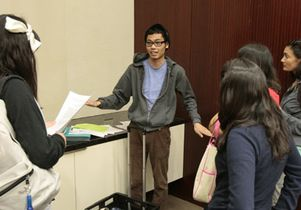 students-approach-rene-after-class