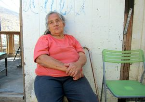 Woman sits outside Tijuana clinic