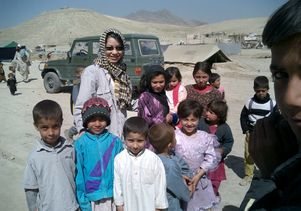 Tigon Abalos with Afghan refugees