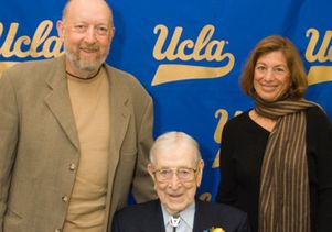 Howard Welinsky and Karren Ganstwig with Coach John Wooden
