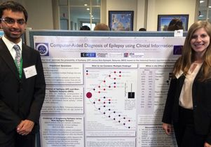 Akash Patel and Sarah Barritt with their poster