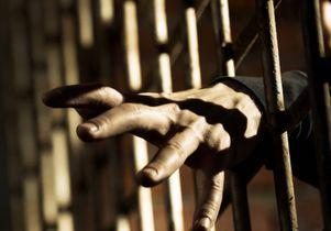 jail bars and an inmate