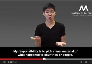 UCLA student Joanna Fan signs museum guide
