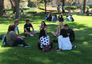 Incoming freshmen gather in small groups after a presentation on sexual violence and other issues to share ideas and opinions and to ask questions.