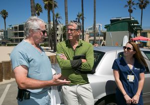 Dr. Gil Cryer (from the left), chief of trauma and emergency surgery at Reagan UCLA Medical Center, talks with Robert Kilroy and Molly Steele
