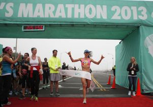 UCLA student Emily Gordon crosses finish line