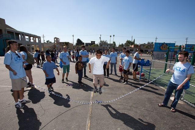 UCLA student volunteers help students at Los Angeles Elementary School get some exercise by jumping rope as part of UCLA Volunteer Day 2014.