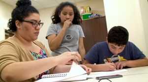 Arts educator Brianda Perez and middle-school students at St. Sophia's