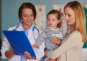 Mom and child with doctor