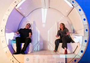 Two attendees in prototype of the Hyperloop