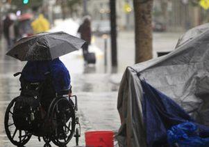 Homeless woman in the rain