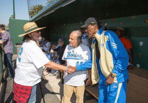 Veteran David Rivas meets Rafer Johnson and Nick Mastromatteo