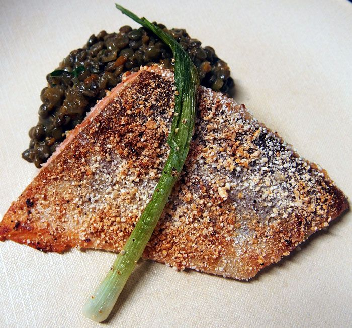 Toasted rice-encrusted trout with coconut curried lentils