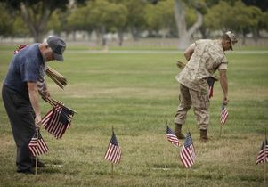 Volunteers pick up flags after Memorial Day