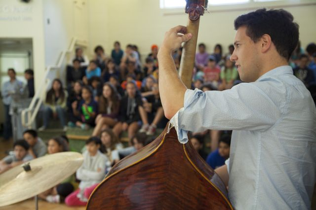 Alex Boneham, bass player, speaks to students at the UCLA Lab School.