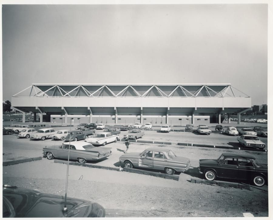 1960s cars parked outside Pauley