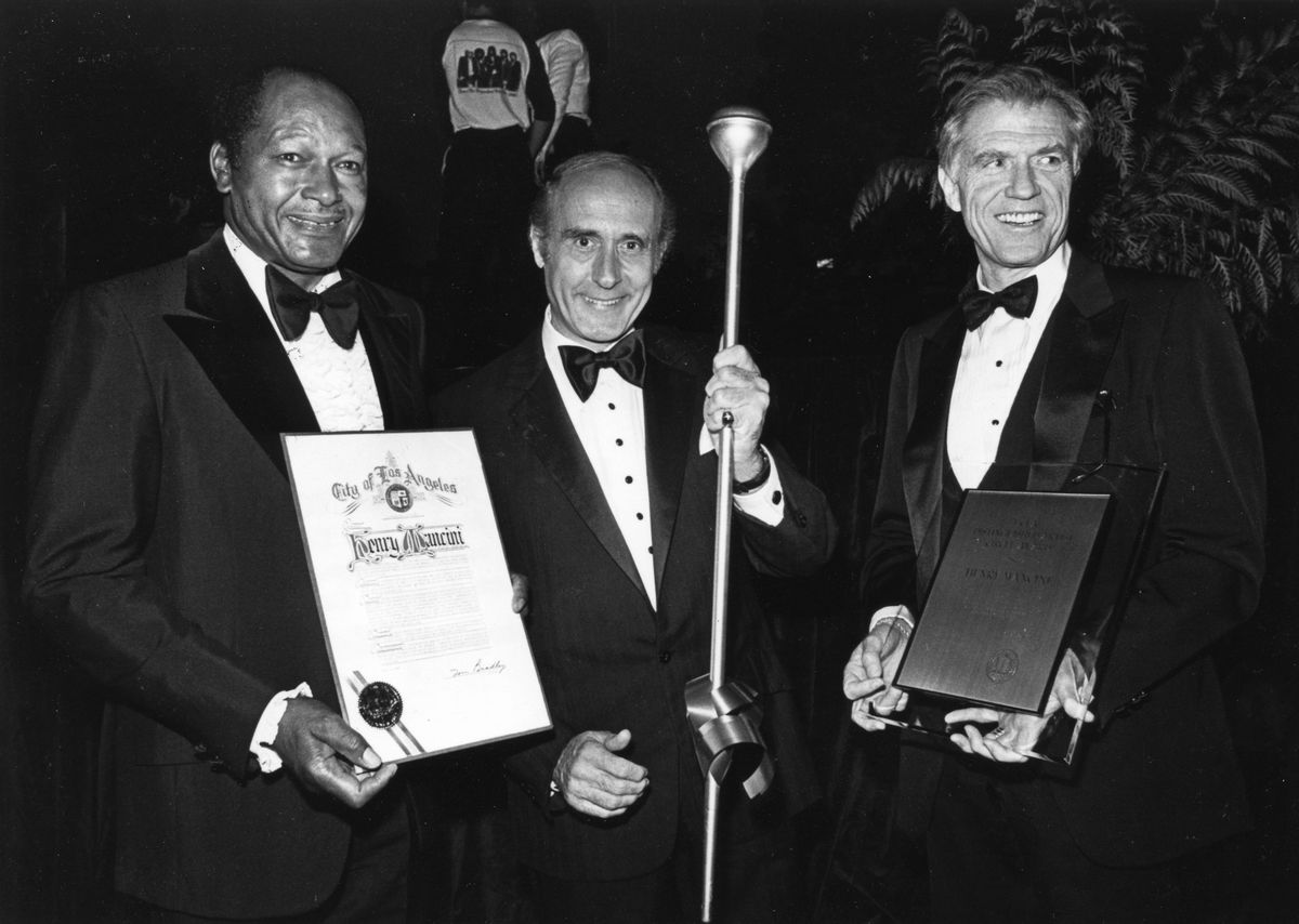 UCLA alumnus and Los Angeles Mayor Tom Bradley; composer Henry Mancini; UCLA Chancellor Charles E. Young.