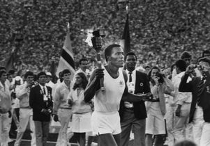 Rafer Johnson carries 1984 Olympics torch