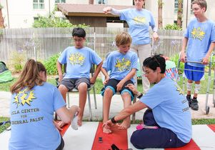 Student volunteers and campers at Camp Leg Power