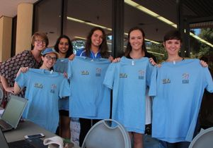 UCLA Volunteer Center and UCLA Recreation show off t-shirts for volunteers