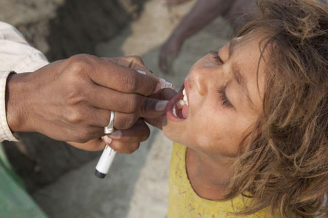 Child in Bihar, India, gets polio vaccine.