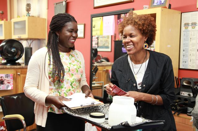 Ph.D. student Teni Adewumi (left) and a hairstylist