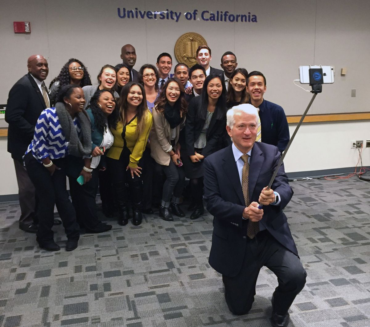 UCLA Chancellor Gene Block takes a selfie with delegates to Washington, D.C.