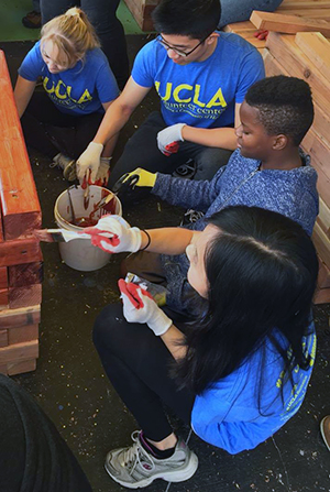 UCLA student volunteers paint at the Al Wooten Jr. Heritage Center as part of Martin Luther King Jr. day of service activities in January 2016.