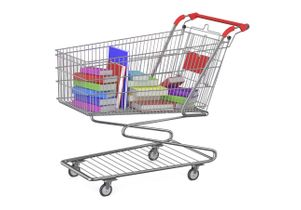 Image of books and course readers in a shopping cart