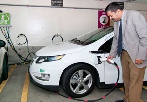Engineering professor Rajit Gadh fuels an electic car