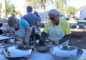 Volunteers work at the Westside Thanksgiving Community Dinner and Celebration