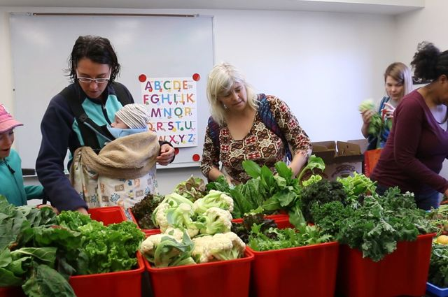 Graduate student families select produce at UCLA University Village