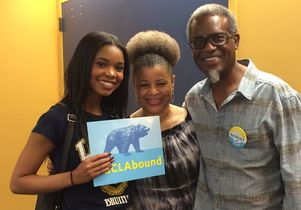 Amora Haynes with her mom, Wendy, and dad, Malik.