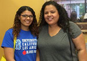 Victoria Martinez, left, and her college counselor Janeth Monzon shortly after Martinez submitted her statement of intent to register at Bruin Day 2016.