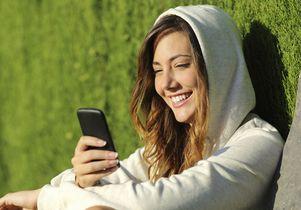 Teenager using phone
