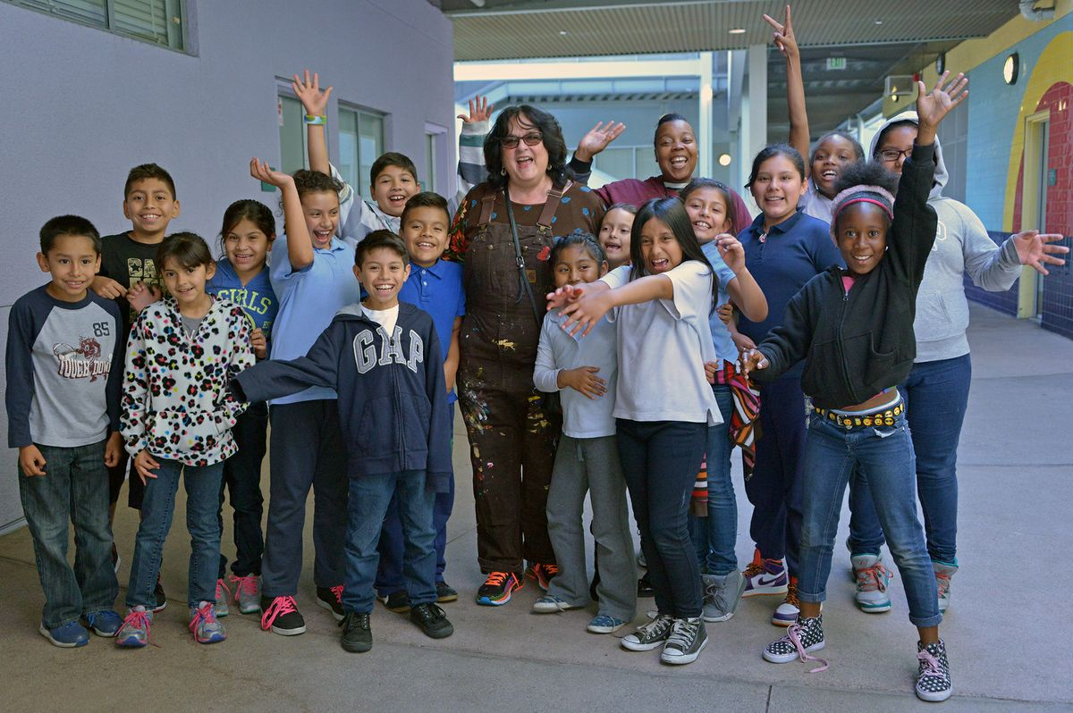 Judy Baca and students