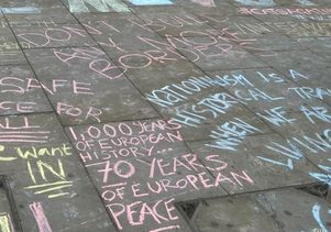 Chalk writing at Remain rally around the Brexit vote.